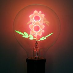 These light bulbs feature unique flower filaments. Available in sunflower, rose or morning glory. 3-5 Watts. Clear glass Medium E27 base. 220V. Diameter 70mm. Please allow 1-2 weeks for shipping.