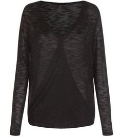 """Throw this on with blue ripped knee skinny jeans and ankle boots this season for the perfect laid back look.- Fine knit- Wrap front- Simple long sleeves- V neckline- Casual fit- Model is 5'8""""/176cm and wears UK 10/EU 38/US 6"""