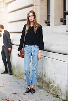 25 Ways to Make Mom Jeans Look Modern - black wide sleeve sweatshirt + mom jeans and black loafers | StyleCaster