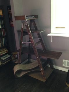 DIY cat tree I made from a wooden ladder and pieces of inexpensive pine boards.
