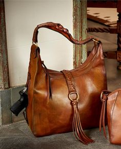 b917a3ca2 The concealed carry handbags from our Braided Handbag collection each  feature a zippered pocket perfect for