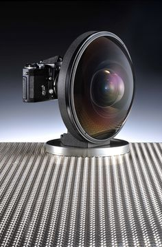 Nikon Gear... this Fisheye-Nikkor 6mm f/2.8 was credited as the world's most extreme wideangle lens to cover the 24x36mm image area when it was unveiled at the Photokina trade show in Cologne, Germany in 1970. It weighs a whopping 5.2kg, is 171mm long and has a diameter of 236mm. It's for sale for a cool £100,000 in London right now.