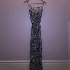 Maxi-dress Thin long maxi dress great for hot weather.  You can tie it to fit your shape. Lace at the top with buttons. Free People Dresses Maxi
