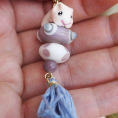 collier sautoir hamster perles de verre pompon violet