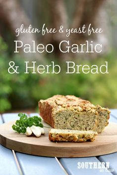 This Paleo Garlic and Herb Bread Recipe is yeast free and an easy one bowl recipe. Gluten free, dairy free, clean eating friendly and sugar free, it is the perfect side dish or great as a sandwich bread or toast alternative. Almond flour, flaxseed and coconut flour are just some of the nutrient packed ingredients in this simple and delicious recipe!