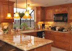 Oak cabinets w/light countertops