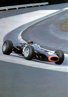 Graham Hill (BRM F1) Carrusell Corner, Nurburgring Nordschleife