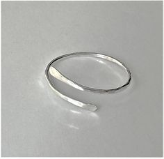 These dainty and thin, hammered 925 sterling silver or 14K gold filled rings.These rings are great for stacking with other rings or for wearing alone for a simple and chic look! These rings are adjustable.  Sold singly.