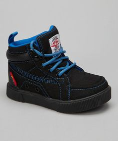 Kick that playground style up a notch with these super-cool sneaks. The hi-top design will keep a small stride looking sleek, while the sturdy rubber soles are built to endure endless adventure.