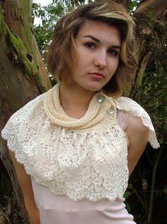 One of a kind gorgeous knitted collar and lace capelet..Seen here with corsage ( not included)This item is perfect for a Winter wedding..Made from cotton yarn, pearl buttons and lace (lace may vary)A stunning and unique piece!!One size..