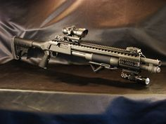 Mossberg 500/590/590A1 Tactical Rail If I ever get my gun back this is what I will do to it