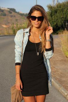 Denim shirt over a black dress