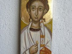 The First martyr Stephen, Stefan or Stefanus, in repurposed wood (from an old box of mine). The saint is wearing the deacons vestments, holding a censer and a miniature church building. There is also an element of his traditional imaging: The sign of his martyrdom, the stone on his head.