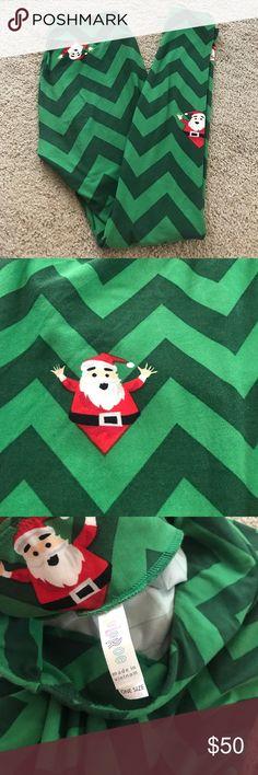 233274c1b78e62 Lularoe Christmas leggings NWOT Lularoe Christmas leggings in os one size.  Two tone green chevron stripped with red little Santa that pops.