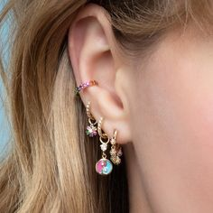 This petite yellow gold style features delicate rainbow diamond balls that shimmer and shake to give these huggies life. Ear Jewelry, Cute Jewelry, Jewelry Findings, Jewelry Accessories, Fashion Accessories, Bijoux Piercing Septum, Cool Piercings, Conch Earring, Cute Earrings