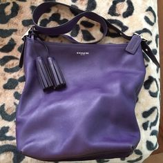 COACH Legacy satchel duffel purse purple Great purse I hate to sell as it has a handy outside large pocket for keys a large inside pocket, two pockets on other inside. Tassels and coach tag in excellent condition as well as purse inside and out. There is wear on corners and slight indent on front left from sneaker Coach Bags Satchels