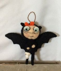Hey, I found this really awesome Etsy listing at https://www.etsy.com/listing/245467308/needle-felted-bat-ornament-ooak
