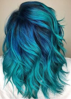Teal hair with cobalt roots.