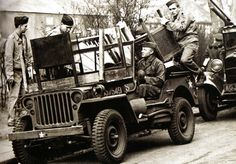 American soldiers use their jeep to help in the rescue work and fire fighting during the German bombing raids on London - 1944