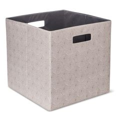 Bring home endless storage possibilities with this 13 Inch Fabric Cube Storage Bin from Threshold. The cutout handles give you easy mobility and the storage unit is an ideal addition for your home or office use. The storage box can store files, paper and all your other essentials. These bins fit perfectly into any shelf and provides you with a large storage space.