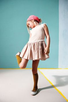 adore her perfectly mini dress that's understated and chic with her mustard knee highs.  #designer #kids #fashion #estella