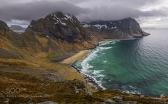 Photo of a beach in Lofoten which name I forgot. Despite de rain showers and the strong wind my friend and I managed to climb all the way up to enjoy these magical views worth to photograph! Enjoy!