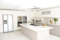 A Nolte Manhattan Handleless kitchen with various appliances to cater for the complex needs of the family
