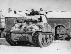 A tank is camouflaged with sheets taken from the Germans to make it less visible in the snow . (Getty)