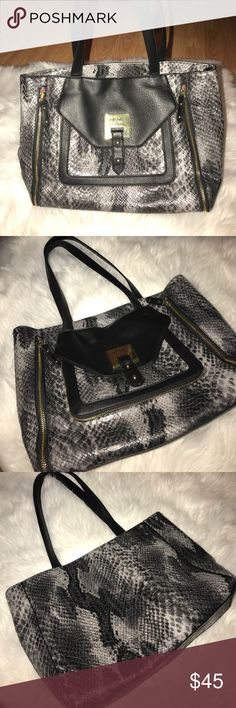 NICOLE MILLER HANDBAG Soft canvas and pink interior NWOT! Very classy snakeskin design, no flaws... black and grey with pretty mirror hardware. Perfect size bag fits all the necessities!  11L by 15W and 10' strap drop. Nicole Miller Bags Shoulder Bags
