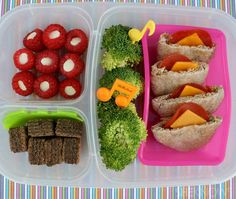 Mini Pita Pockets bento box lunch  On the right side there are fresh broccoli florets, and mini pita pockets stuffed with cheese and turkey pepperoni. On the left, there are vanilla chip stuffed raspberries (They could also look cute with blueberries in them), and chocolate wafers for dessert. All packed in an EasyLunchBox.