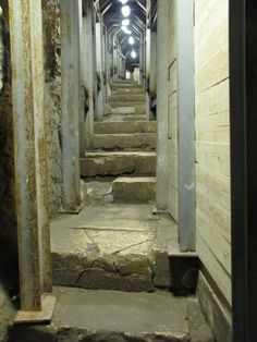 The recently excavated stepped stone street that leads from the Pool of Siloam up to the Temple Mount. The continuation of the street can be seen in the opening further up on the left side of the street. The Temple Mount is 1600 feet (a little more than a quarter mile) up these stairs to the north, but the excavation does not continue all the way to the Temple Mount.