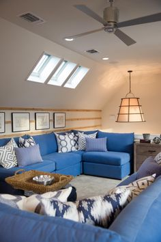 Bright blue sectionals, nap-worthy daybeds and enough seating for 20, this colorful loft is party central.