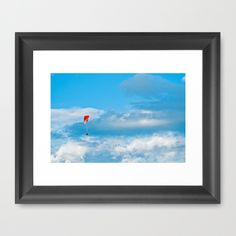 Paraglider above the clouds Framed Art Print A paraglider on a blue but cloudy sky  sport, sky, clouds, blue, flying,red,white,cloudy