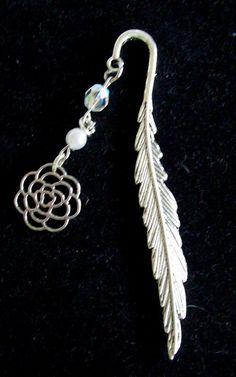 Blingy Bookmarks!  Silver Pewter  Banana Leaf Bookmark with Pearl White and Crystal colored beads with silver tone flower pendant  Edit http://www.facebook.com/thegemtreehandmadejewelryandmore