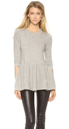 A fitted 10 Crosby Derek Lam sweater gets a feminine twist with a full peplum hem. Metallic thread adds a touch of sparkle, and ribbed banding trims the neckline. 3/4 sleeves.