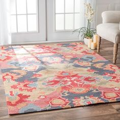 Freshen up your family room with the vibrant blooms on this multicolor rug from nuLOOM. The fusion of bold, bright colors livens the look of neutral contemporary furnishings, creating a daring style s