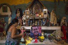 Venezuelan espiritismo altar  Hugo Chavez Santeria Maria Lionza Bolivar