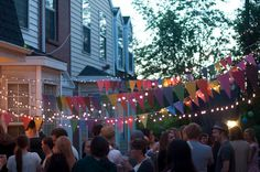a summer party = pennants and light between trees
