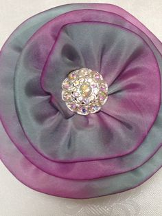 This delicate handcrafted Pink/Grey 100% Silk Kippah will turn heads in your direction. A beautiful swirl of rhinestones adorns the center. Offered by Vintage Blooms By Ellen on Etsy for $35.