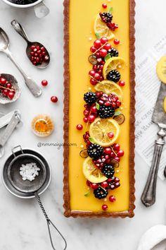 Passion fruit & lemon tart with chocolate crust ( Vegan, Gluten-free & refined sugar-free) List Of Desserts, Vegan Desserts, Plated Desserts, Tart Recipes, Almond Recipes, Pie Dessert, Dessert Recipes, Passion Fruit Juice, Fruit Tart