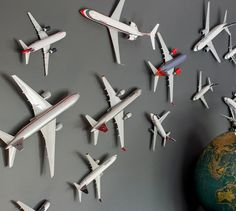 dark grey as a wall color. Makes everything pop, like these mounted toy airplanes + globe.Loving dark grey as a wall color. Makes everything pop, like these mounted toy airplanes + globe. Airplane Decor, Aviation Decor, Displaying Collections, Kid Spaces, Kids Bedroom, Boys Airplane Bedroom, Baby Bedroom, Bedroom Ideas, Bedroom Toys