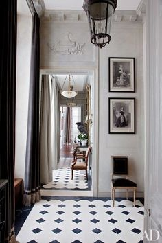 Curtained in a Romo velvet, a light-filled entrance hall greets visitors at a Paris apartment renovated and decorated by Deniot | archdigest.com