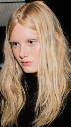 A simple solitary middle-part braid is popping up on models everywhere