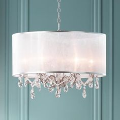 This elegant chandelier, from Possini Euro Design, features a sculptural antique silver frame behind a sheer organza shade.