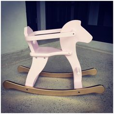 Pink and gold rocking horse