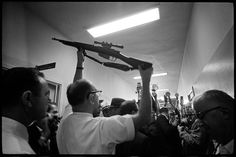 Oswald's gun, Dallas Police Station, November 23, 1963  by Lawrence Schiller photographer