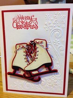 Cricut Winter woodland cartridge ice skates, Darice snowflake swirl embossing folder. Love how it turned out.