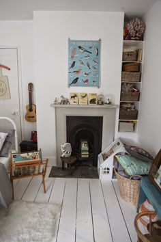 junkaholique, little girls room, bedroom, style, poster, fireplace, storage, wooden floors, home, interior, books, cushions