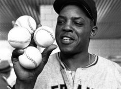 FILE - In this Aptil 30, 1961, file photo, San Francisco Giants star outfielder, Willie Mays, proudly displays the four baseballs in the clubhouse representing the four homers which he hit against the Milwaukee Braves in Milwaukee.  The four homers tied the record of four homers in a single game held by nine other major league players at the time.  The  Giants won 14-4.  Willie's homers accounted for eight runs batted in.(AP Photo/File)
