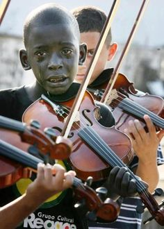 Diego Frazão Torquato, 12 year old Brazilian violinist playing at his mentor's funeral. Photo Credit: Mark Tristan